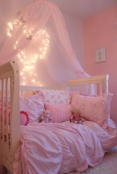 Add some sparkle to the room with mini LED lights! I used small adhesive hooks to create the heart shape with the lights, and chose a white cord instead of green. Because this is a toddler room, these lights aren't always turned on. Leave that for special evening story times, or turn them on and off with a timer attachment.