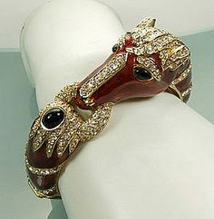 This circa-1960 enamel horsehead bracelet by Ciner is a highly collectible (and affordable) costume piece in the style of fine jeweler David Webb. Available for $650 at rubylane.com