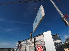 Unloading prefabricated panels. #panelhouse #timberhouse Timber House, Prefab Homes, Netherlands, Opera House, Construction, Building, Prefab Cottages, The Nederlands, Wood Frame House