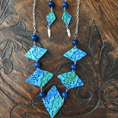 Jewelry sets Sets necklace Boho jewelry set Boho necklace set Boho earring set Tribal necklace set Celtic necklace set-This is a blue and green multiple pendant necklace and matching earrings. The beads are blue dyed jade. The necklace is 11.5 inches long. It hangs to the upper chest. I will adjust the length of the chain to your liking. The earrings are matching with the same leaf pattern and are adorned with beads and silver feather charms.