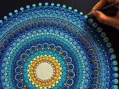 Elspeth McLean wonderful sun and sky mandala in blue, turquise and yellow