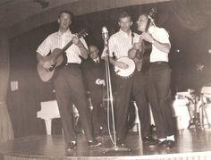 The Kingston on tour. Dave Guard, Bob Shane and Nick Reynolds, with David Buck Wheat on bass. (1958)