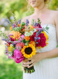 colorful bridal bouquet with sunflowers, poppy, larkspur, lavender, physostegia, dahlias, roses