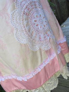GARAGE SALE..!! $65!! less than half price..! I have to clear my racks..! Making way for new creations..! I love this skirt.. ! pretty pink and white panel skirt, brocade, satins, laces.. Ive added vintage laces and needlework, doilies, ribbons and roses... the skirt is a basic A-line shape with a side zip and wide flat waist band.... Ive added one large special main doily to the front with pink flowers and added pearl centres and mother of pearl buttons with a few other doilies scattered…