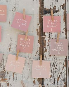 Different shades of pink for name cards for the tables, maybe on strings like this with a different kind of clip (gold clip)