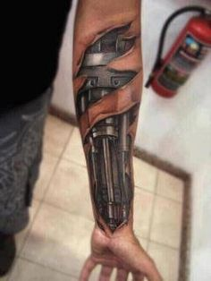 robotic arm tattoo. fierce!