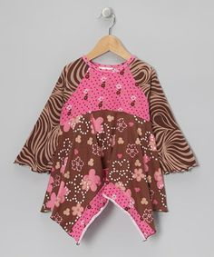 This tunic's brilliant prints and handkerchief hem rustle up smiles wherever it goes. A stretchy cotton-blend and a babydoll design craft an easy fit that's comfortable on active girls who have a full day of looking sweet ahead of them.
