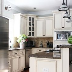 A beautiful cozy kitchen with a functional island.