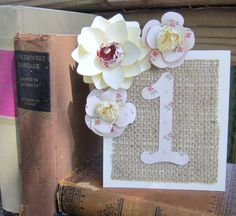 Handmade Paper flower table numbers, with matted burlap.