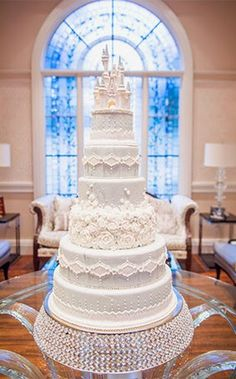 This romantic confection is currently on display at Franck's Studio and all who encounter it are left breathless...and a little hungry! http://bit.ly/1FB5qsY #Cake #Wedding #Cinderella #Castle