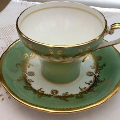 Art Deco Aynesley bone china and saucer with heavy quality gilding apple green ground bell shape