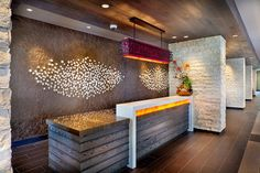 Front Desk. Wood. White-Duco. Granite table top. Warm-fluorescent. Craft. Hanging light.White-stone-wall.