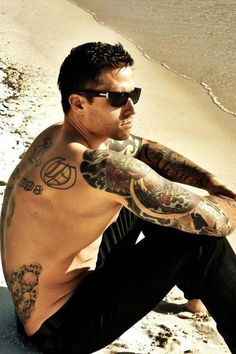 Something about a dude with tatts on the beach. Hot.