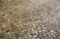 Permeable paving - makes a gorgeous, cooler driveway and lets water seep into the ground where it's purified naturally instead of running, contaminated into storm drains.
