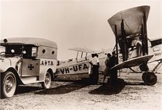 Royal Flying Doctor Service.VH-UFA was a DH-50A built in 1926 by Qantas at Longreach. Photo probably from 1932 judging by the Queensland Ambulance Transport Brigade vehicle. Aircraft had a two oerson enclosed cabin in FRONT of pilot in open cockpit.