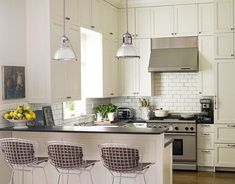 In my someday kitchen I want white cabinets and these fantastic wire bar stools and light fixtures