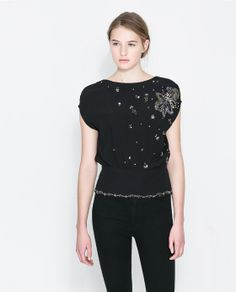 Image 1 of EMBELLISHED BLOUSE WITH V BACK from Zara