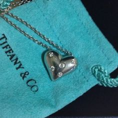 Platinum Tiffany Bubble Heart with Diamonds Stunning platinum pendent with substantial solid heart and 5 brilliant diamonds ...  Venetian chain, marked and stamped both in the solid pendant's heart and on the chain lock ... Limited edition, original box, pouch, gift box, and even the receipt - receipt will not be included in this sale since personal info. Is included.  Purchased from Tiffany South Coast Plaza.  Sold out within weeks ... No low balling and serious buyers Si Vous Plait... ❤️…