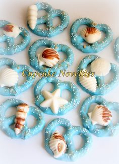 Cupcake Novelties - Cakes, Cupcakes, Wedding Cakes, Cake Pops, Cookies, Pie Pops in Fairfax, VA!: Under the Sea themed Seashell topped Chocolate Dipped Pretzels Under the Sea Party Favors Cookies Dessert Table