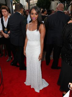 Aja Naomi King in Alice + Olivia top and skirt, Kurt Geiger shoes, a Rauwolf clutch, and Carrie Hoffman jewelry - NAACP Image Awards 2015