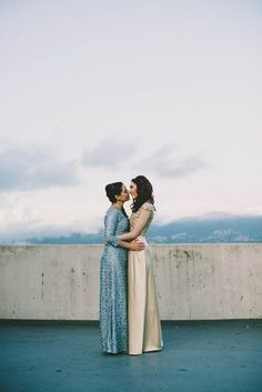 Custom-made wedding dresses by Nicole Guzzo in dusty blue and metallic gold | Sara Rogers Photography