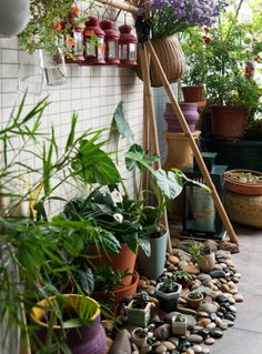 Bring the outdoors to an urban balcony by layering big and small plants | Reko's apartment #IKEAIDEAS