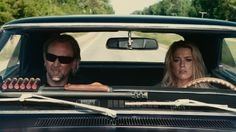 """Hell escapee John Milton (Nicolas Cage) and young waitress Piper (Amber Heard) are unlikely companions on a road trip through America's heartland in """"Drive Angry."""" -- Drive Angry Blu-ray Review"""