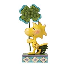 4049395 Luck of The Woodstock- It's Woodstock's lucky day. Snoopy's best friend celebrates St. Patrick's Day with a four leaf clover in this heartwarming design uniting the beloved Peanuts character with the artistry of Jim Shore #stpatrick #irish #peanuts