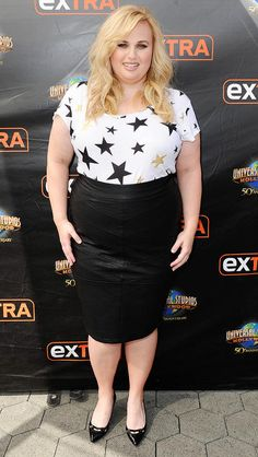 REBEL WILSON in a starry top and pencil skirt (from her upcoming collection with Torrid) while visiting Extra in Universal City, Calif.  |  Noel Vasquez/Getty Updated: Friday Oct 30, 2015 | 5:41 PM EDT