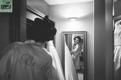 The bride shows off her dress. Weddings at Druids Glen Resort by Couple Photography.