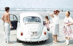 This German family decided to travel in their Volkswagen Beetle to the North Sea for their summer holidays. In 1966, when this photo was taken, you could drive straight onto the beach and up to the water. To gain additional space, many owners added an optional luggage rack on the top of the car or, in this case, to the rear.