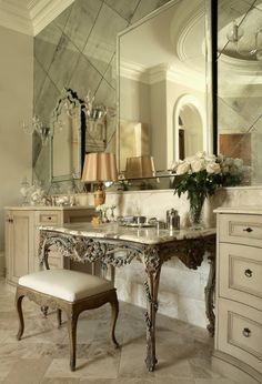 Mirrored tile wall set diagonal with large mirrors on top, very chic