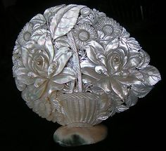 carved mother of pearl display piece with flowers