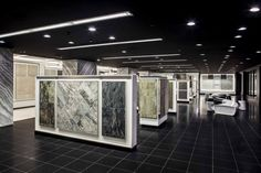 The Olympia Tile showroom in Toronto. Showroom Interior Design, Tile Showroom, Retail Interior, Commercial Interior Design, Commercial Interiors, Olympia Tile, Metal Stairs, Shop Fittings, Display Design