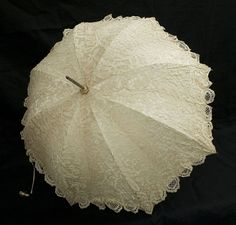 Brussels lace parasol with ivory handle, 1860s, [2nd of two pins]