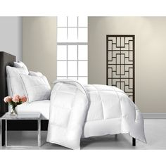 This beautiful duvet is soft and breathable for comfort and warmth. Constructed of fine quality cotton, down and down alternative, this elegant comforter is also machine washable for convenience. http://www.overstock.com/9613521/product.html?CID=245307