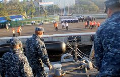 Sailors throw mooring lines to the pier as the Oliver Hazard Perry-class guided-missile frigate USS Vandegrift (FFG 48) arrives for a port visit in Vladivostok, Russia. (U.S. Navy photo by Ensign Erik M. Selberg/Released)