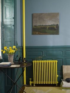 Paint your radiator and pipes a SUPER bright accent color. | 26 Insanely Adventurous Home Design Ideas That Just Might Work