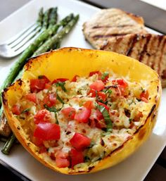 Baked Margherita Spaghetti Squash |  Tip: Slice Spaghetti Squash in half, place in a corningware bowl face down, and fill with about one inch of water. Bake 40 minutes @ 350. Cooks perfect every time.