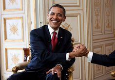 Obama shakes hands with Sarkozy