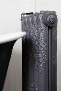 old cast iron radiator (detail), apartment on the river Vecht, Netherlands: Remy Meijers