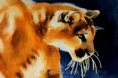 A framed original golden mountain lion portrait watercolor fine art painting in gold and blue. Description from etsy.com. I searched for this on bing.com/images