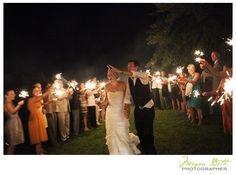 Bride and groom walk through group of sparklers. Woodlawn Estates, Southern Maryland. Rustic, country waterside wedding. http://woodlawn-farm.com/