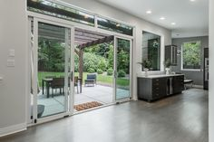 Sliding doors opening into the gorgeous backyard in Bonnie Brae | 3040 E Exposition, Denver |