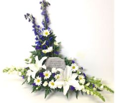 """Blue and white fresh cut arrangement with a memorial stone that reads, """"Those we love don't go away, they walk beside us everyday. Unseen, unheard, but always near, so loved, so missed, so very dear."""" Fresh flowers include white lilies, blue delphinium, white daisies, white miniature carnations, and statice. Stone: 7w x 5h Sympathy Funeral Keepsake Gift"""