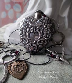 STERLING VALENTINE - vintage assemblage necklace with silver repousse heart perfume locket, garnets and chain by the french circus