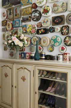 .tins hung on wall