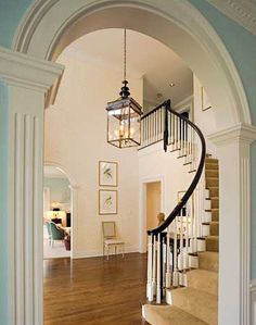 Gorgeous millwork, double height ceiling, graceful bridal staircase