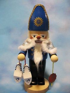|| Steinbach 2013 Dutch Santa Nutcracker || From Steinbach's collection of European Santas, this Dutch version features Santa clad in blue and holding his wooden shoes. Measures 12 inches tall and hand-signed by Karla Steinbach. NS1393 #Steinbach #nutcrackers #Dutch #Santa