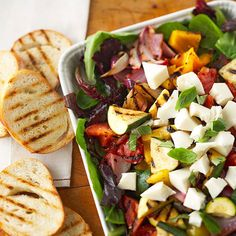This seasonal dinner is full of fresh veggies, mozzarella, and topped off with a pear-infused vinaigrette. More garden-fresh salad recipes: http://www.bhg.com/recipes/salads/ideas/garden-fresh-salads/?socsrc=bhgpin061013ensalada=8